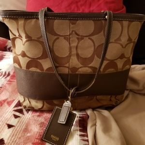 Coach with wristlet